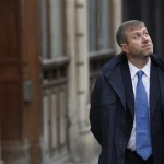 Russian billionaire and owner of Chelsea football club Abramovich walks past the High Court in London